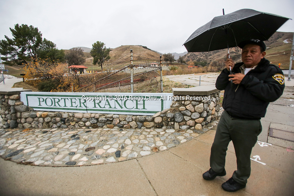A security stands guard near the Aliso Canyon storage facility at the Porter Ranch area of Los Angeles, California, the United States on January 6, 2015.  California Gov. Jerry Brown declared a state of emergency today in the Porter Ranch area due to the continuing leak of natural gas from the Aliso Canyon storage facility. The leak at Porter Ranch started in October, and likely won&rsquo;t be fixed for at least two more months. Officials have relocated several thousand residents who said the stench made them sick.(Xinhua/Zhao Hanrong)(Photo by Ringo Chiu/PHOTOFORMULA.com)<br /> <br /> Usage Notes: This content is intended for editorial use only. For other uses, additional clearances may be required.