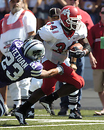 Fresno State running back Bryson Sumlin (34) rushes by Kansas State's Jesse Tetuan (23) for a Bulldog first down in the first half at KSU Stadium in Manhattan, Kansas, Sept. 11, 2004.  Fresno State defeated Kansas State 45-21.