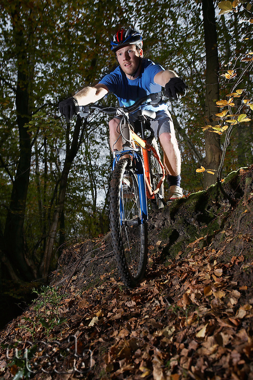 Mountain biker in woodland