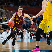 Loyola University Chicago junior Ben Richardson dribbles the ball against the University of Michigan in the first round of the Final Four in the NCAA Tournament at the Alamodome in San Antonio, TX., on Saturday, March 31, 2018. (Photo: Lukas Keapproth)