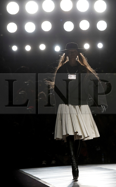 © London News Pictures. 15/02/2013. London, UK. A model walks the runway at the KTZ show by designers Marjan Pejoski  and Koji Maruyama  at London Fashion Week Autumn Winter 2013/14 on February 15, 2013. Photo credit : Ben Cawthra/LNP