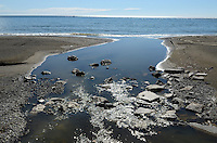 River enters sea, beach, Mediterranean, Mediterraneo, Estepona, Malaga, Andalucia, Andalusia, Spain, Espana, Costa del Sol, tourism, travel, holidays, 201302201097..Copyright Image from Victor Patterson, 54 Dorchester Park, Belfast, UK, BT9 6RJ..Tel: +44 28 9066 1296.Mob: +44 7802 353836.Voicemail +44 20 8816 7153.Skype: victorpattersonbelfast.Email: victorpatterson@me.com.Email: victorpatterson@ireland.com (back-up)..IMPORTANT: If you wish to use this image or any other of my images please go to www.victorpatterson.com and click on the Terms & Conditions. Then contact me by email or phone with the reference number(s) of the image(s) concerned.