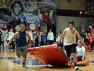 """10th grade Blue Team members compete in an event where two people pull a third on a gym mat on the first night of Gym Night at Neshaminy High School Friday February 27, 2015 in Langhorne, Pennsylvania. The theme of this year's competition is """"Made in America"""" and blue teams and red teams from each grade are spotlighting different states. (Photo by William Thomas Cain/Cain Images)"""