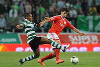 20120409: LISBON, PORTUGAL -Portuguese Liga Zon Sagres 2011/2012 - Sporting CP vs SL Benfica.<br /> In picture: Sporting's Elias, left, fights for the ball with Benfica's Nelson Oliveira.<br /> PHOTO: Alvaro Isidoro/CITYFILES