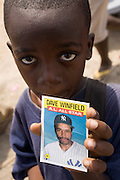 Abas Zuberu, 8, holds a player card picturing MLB Hall of Famer Dave Winfield in Tema, roughly 35 km east of Ghana's capital Accra on Saturday February 3, 2007. An exhibition game was being held on the occasion of the visit of a delegation from the American Major League Baseball Association made possible by the African Development Foundation, a non-profit organization that supports little league projects in selected African ..