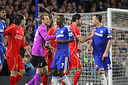 Chelsea's John Terry argues with Liverpool players during the Capital One Cup match between Chelsea and Liverpool at Stamford Bridge, London, England on 27 January 2015. Photo by Phil Duncan.
