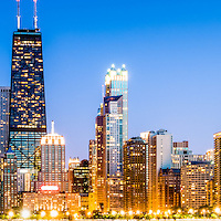 Chicago panorama skyline at twilight photo. Includes the John Hancock Center building and other popular downtown Chicago city buildings at dusk. The John Hancock Center is one of the world's tallest skyscrapers and is a famous fixture in the Chicago skyline. Panorama photo ratio is 1:3.