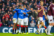 Ryan Kent (#14) of Rangers FC is surrounded by team mates after scoring Rangers second goal during the Ladbrokes Scottish Premiership match between Rangers FC and Heart of Midlothian FC at Ibrox Park, Glasgow, Scotland on 1 December 2019.