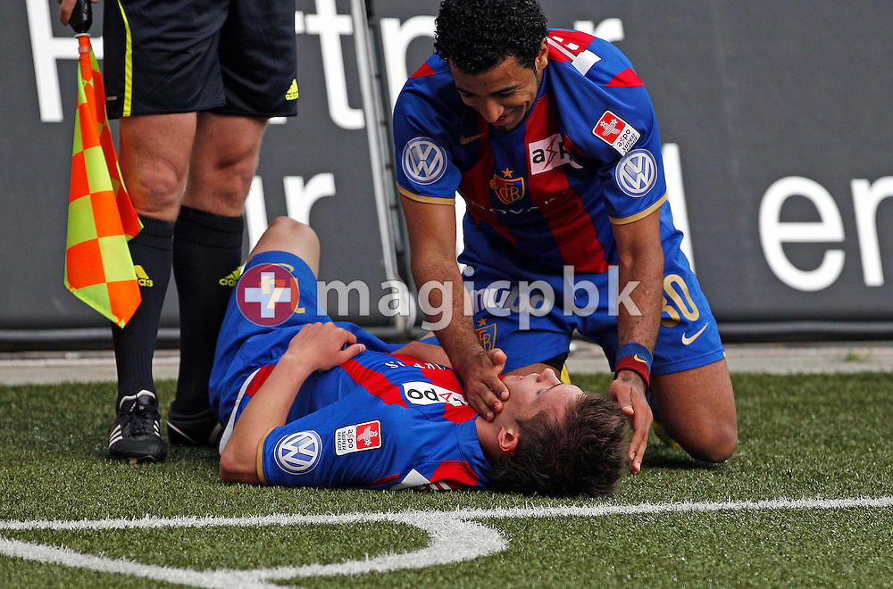 FC Basel midfielder Valentin Stocker (no. 14) is being celebrated by his teammate Alves Garcia Carlos Alberto Carlitos (R) after scoring to the score of 0-1 during the Super League (National League A) soccer match between BSC Young Boys (YB) and FC Basel (FCB) at the Stade de Suisse stadium in Bern, Switzerland, Sunday, Mai 16, 2010. FC Basel have won the Swiss football championship beating Young Boys of Bern 2-0 in the last match of the season. (Photo by Patrick B. Kraemer / MAGICPBK)