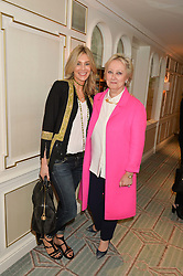 Left to right, KIM HERSOV and PAMELA HARPER Chairman & CEO of Halcyon Days at a breakfast hosted by Halcyon Days at Fortnum & Mason, 181 Piccadilly, London on 8th July 2014.