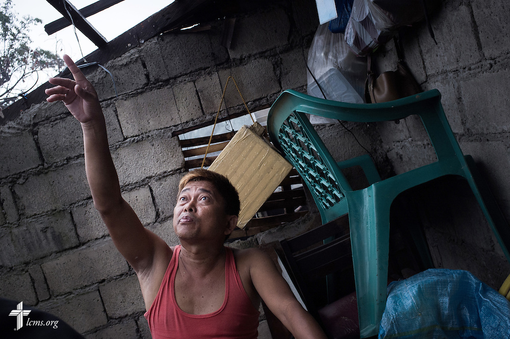 Leonardo Lopez, a member of Christ Lutheran Church in Tacloban, shows where his roof was destroyed by Typhoon Haiyan in Tacloban, Leyte Province, Philippines, on Friday, March 14, 2014. LCMS Communications/Erik M. Lunsford