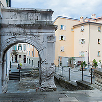 Roman ruins and colorful houses of the old city (Città Vecia) in Trieste, Italy