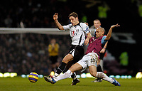 Photo: Leigh Quinnell.<br /> West Ham United v Fulham. The Barclays Premiership. 13/01/2007. West Hams new signing Nigel Quashie tackles Fulhams Michael Brown.