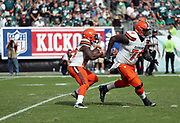 Cleveland Browns running back Duke Johnson, Jr. (29) follows a down field block from Cleveland Browns offensive lineman Cameron Erving (74) with the NFL Kickoff 2016  banner hanging on the wall in the background during the 2016 NFL week 1 regular season football game against the Philadelphia Eagles on Sunday, Sept. 11, 2016 in Philadelphia. The Eagles won the game 29-10. (©Paul Anthony Spinelli)