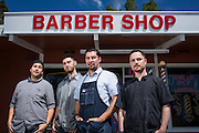 From left to right Fabi Gomez, Chris Ramsour, owner Alex Franco, and Garrison Finks pose for a portrait outside Alex's Classic Barber Shop & Shaves in Fremont, California, on April 9, 2014. (Stan Olszewski/SOSKIphoto)