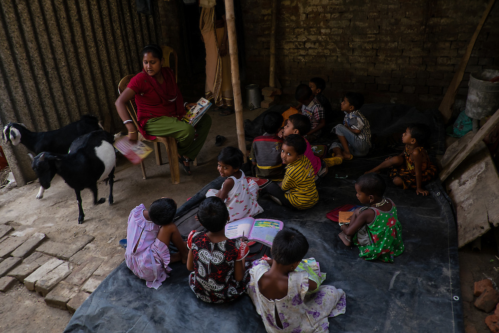 students sit inAnanda Siksha Niketan ( home of joyful learning ), Bhabta, Murshidabad, West Bengal, India, on  April 11, 2015.<br /> Photo by Oren Nahshon