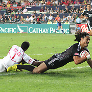 NZ Samoan heritage player, Ben Lam, gets by USA Eagle speedster Carlin Isles to help NZ 7's prevail 24-12 in Day 2 at the Hong Kong Sevens Rugby, Hong Kong Stadium, Hong Kong, 3/23/13.  Photo by Barry Markowitz, Courtesy Tri Marine/Samoa Tuna Processors