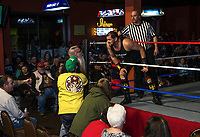 Josef Von Schmidt gets in the face of an audience member as the referee brings him back to the ring during Injustice for Brawl at the Whiskey Barrel Saturday night.   (Karen Bobotas/for the Laconia Daily Sun)