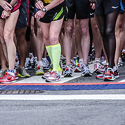 Runners legs at the start line of the 2012 Cherry Blossom 10-Miler, the 40th running of the race that is run every spring in Washington DC to coincide with the National Cherry Blossom Festival. The course starts near the Washington Monument, heads over Memorial Bridge and back, goes up under the Kennedy Center, around the Tidal Basin and past the Jefferson Memorial, and then does a loop around Hains Point back to the finish near the Washington Monument.