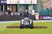 A goundsman on a tractor brushing the outfield to dry the surface as play is delayed after a heavy shower during the Specsavers County Champ Div 1 match between Somerset County Cricket Club and Essex County Cricket Club at the Cooper Associates County Ground, Taunton, United Kingdom on 26 September 2019.