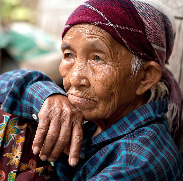 Old woman in hill tribe village in northern Thailand