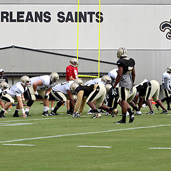 July 28, 2012; Metairie, LA, USA; New Orleans Saints quarterback Drew Brees (9) under center during a training camp practice at the team's practice facility. Mandatory Credit: Derick E. Hingle-US PRESSWIRE
