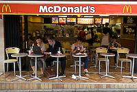 Customers in a McDonald restaurant in Omote-Sando dori, Tokyo.