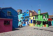 Burano island. Laundry drying in the fresh breeze between colorful houses.