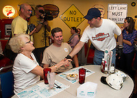 Mable and Jeff Wichterman from Meredith shake hands with Republican Presidential Candidate Scott Walker during his stop at the Route 104 Diner in New Hampton on Sunday evening as part of the Walker Harley Tour.  (Karen Bobotas/for the Laconia Daily Sun)