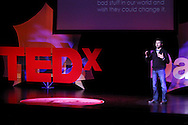 Brad Doudican speaks during TEDx Dayton at the Victoria Theatre in downtown Dayton, Friday, November 15, 2013.  TEDx Dayton is a localized version, and uses a format similar to national TED (Technology, Entertainment, Design) events.