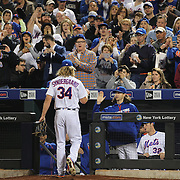 NEW YORK, NEW YORK - APRIL 25: Pitcher Noah Syndergaard #34 of the New York Mets is congratulated by team mates Jacob deGrom as he returns to the dug out after being withdrawn from the game in the seventh inning  during the New York Mets Vs Cincinnati Reds MLB regular season game at Citi Field on April 25, 2016 in New York City. (Photo by Tim Clayton/Corbis via Getty Images)