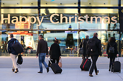 Holiday makers arriving  at London Gatwick airport as the Christmas getaway starts Friday, 20th December 2013. Picture by Stephen Lock / i-Images