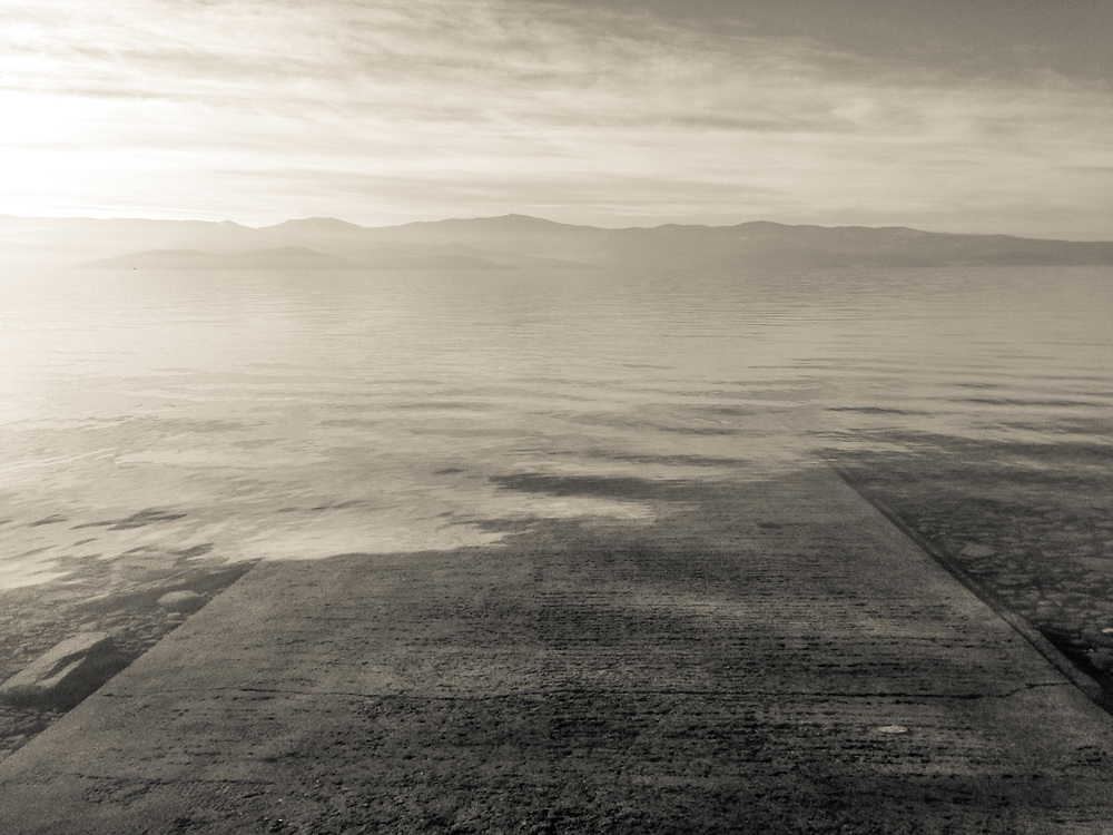 Dreamy view of the concrete boat ramp disappearing into Flathead Lake