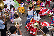 Indigenous people dance through Oaxaca streets, staging an Alternativ Geulegetza, in 2006 in support of APPO.