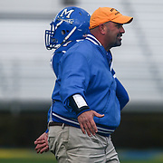 Head Coach Mark DelPercio congratulating his players  during the DIAA division one Football Championship game between Top-seeded Middletown (11-0) and second-seeded Smyrna (11-0) Saturday, Dec. 03, 2016 at Delaware Stadium in Newark.