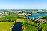 Nederland, Gelderland, Maasdriel 13-05-2019; Bommelerwaard met dorp Alem gelegen op schiereiland in de Maas. In de voorgrond de Maasarm Den Bool, foto richting kanaal van Sint Andries aan de horizon, verbinding tussen Maas en Waal (links). In  het kader van het Maasoeverpark, zal de dam van Alem vervangen gaan worden door een brug. Ook verdere ontwikkeling van het landschapspark met daarin ruimte voor de natuur, de landbouw en gecombineerd  met 'ruimte voor de rivier' en bescherming tegen hoogwater door waterstandverlaging.<br /> Bommelerwaard with the village of Alem on a peninsula in the Maas. In the foreground the Maasarm Den Bool, photo towards the Sint Andries canal on the horizon, connection between Maas and Waal (left). Part of Maasoeverpark, development of a landscape park in which space for nature is combined with 'space for the river', protection against high water by lowering the water level.<br /> <br /> aerial photo (additional fee required); luchtfoto (toeslag op standard tarieven); copyright foto/photo Siebe Swart