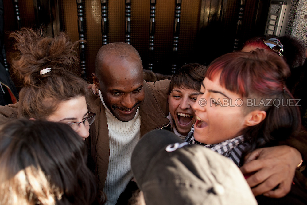 Luis Mendes celebrates with friends, neighbors, and volunteers of M-15, indignant movement and PAH after he wins an extra month, once the Court Stop the eviction by not turning up to his home on January 10 of 2011 in Torrejon de Ardoz, Madrid, Spain. .Luis Mendes is currently an unemployed builder, 45 years old, from Guinea Bissau, and has a wife and 8 children to maintain in Senegal. He lives at his home in Torrejon De Ardoz, Madrid, with his brothers. .Today he is facing a second eviction attempt as he stopped paying the mortgage to Bankia Bank when lost his job in 2009 during the economic crisis. He had to choose between feeding his children or paying the bank. At the moment, he cannot even send money anymore to his family and if he losses his current house, he would gain a live-long debt. He has tried to negotiate with the bank to reach a different solution, by paying a lower monthly fee, but up to now there was no agreement for it..This is also case of many people in Spain that are losing their homes every-days and also gaining debts to banks..According to details of the General Council of the Judiciary, in Madrid there are 40 evictions every-days.