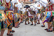 """Feast of """"Mamacha del Carmen"""" of Paucartambo. Waiting to enter the church the dance group called Contradanza stages a choreography."""