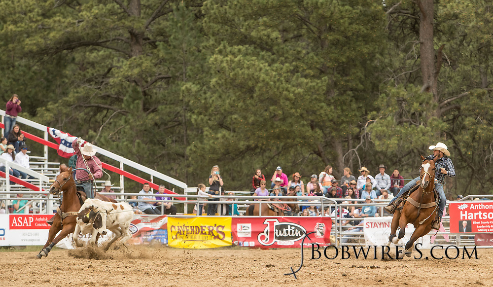 Header Tyler Schnaufer and heeler Trevor Schnaufer make their team roping run during the third performance of the Elizabeth Stampede on Sunday, June 3, 2018.