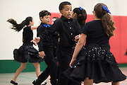 """Students perform their dance routines they learned in a ballroom dancing class at Colin Powell Elementary in Grand Prairie, Texas on October 7, 2016. """"CREDIT: Cooper Neill for The Wall Street Journal""""<br /> PUBLICS"""