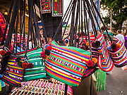 "07 APRIL 2013 - CHIANG MAI, CHIANG MAI, THAILAND:  Handbags for sale during the Chiang Mai ""Walking Street Market."" The Walking Street Market starts at Thapae Gate and runs along the length of Ratchadamnoen Road through the heart of the Old City and has become a Chiang Mai institution. Chiang Mai is the largest town in northern Thailand and is popular with tourists and backpackers.       PHOTO BY JACK KURTZ"