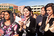 14 JANUARY 2012 - CHANDLER, AZ:    New US citizens applaud after taking the oath of citizenship at a naturalization ceremony in Chandler, AZ, Jan. 14. More than 140 people from 21 countries were naturalized as United States citizens Saturday in Chandler. This is the third year Chandler has sponsored a naturalization ceremony in connection with the Dr. Martin Luther King holiday. PHOTO BY JACK KURTZ