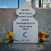 March 27, 2012 - Dublin, Ireland: A satirical gravestone is seen at the entrance of the Billion Euro House art installation by the Irish artist Frank Buckley. ..Worthless euros, taken out of circulation and shredded by Irelands Central Bank, formes the interior walls of an apartment that Mr. Buckley does not own in a building left vacant by the countrys economic ruin...The artist decided to call the apartment  built from thousands of bricks of shredded, decommissioned cash (each brick contains, roughly, what used to be 50,000 euros)  the Billion Euro House. He reckons that about 1.4 billion euros actually went into it, but the joke, of course, is that it is worth simultaneously so much and so little...A large gravestone beside the main door, announces that Irish sovereignty died in 2010, the year that the government accepted an international bailout so larded with onerous conditions that the Irish will be paying for it for years to come. (Paulo Nunes dos Santos/Polaris)