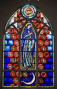 A stained glass image of Mary and the Immaculate Conception from a window at Immaculate Conception Church in Luxemburg, Wis. (Sam Lucero photo)