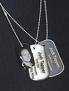 Judi Tapper wears her dog tags and a picture of her son who was killed in Afghanistan in 2003 during an Honorary Commander boot camp for 40 local officials Thursday October 29, 2015 at Joint Base McGuire-Dix-Lakehurst  in Fort Dix, New Jersey. Participants experienced combined arms training, simulated combat environments and enjoyed a military cuisine. (Photo by William Thomas Cain)