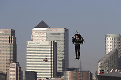 Against the backdrop of the Canary Wharf, pilot David Hayman makes a flight in a jetpack over the Royal Docks in London. JetPack Aviation, the first company to ever produce a personal, lightweight jetpack made history in the UK as its custom designed twin jet engines propelled a man across the open skies of London.
