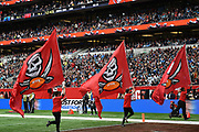 Tampa Bay Buccaneers flag bearers run through the end zone during the International Series match between Tampa Bay Buccaneers and Carolina Panthers at Tottenham Hotspur Stadium, London, United Kingdom on 13 October 2019.