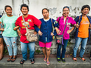10 SEPTEMBER 2016 - BANGKOK, THAILAND: Residents of Pom Mahakan and their supporters lock arms and block the gates of the old fort during an event to express community solidarity in face of Bangkok city officials' efforts to evict them from the fort. Forty-four families still live in the Pom Mahakan Fort community. The city of Bangkok has given them provisional permission to stay, but city officials say the permission could be rescinded and the city go ahead with the evictions. The residents of the historic fort have barricaded most of the gates into the fort and are joined every day by community activists from around Bangkok who support their efforts to stay.                PHOTO BY JACK KURTZ
