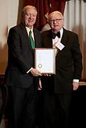 President Nellis presents Tadeusz Malinski her patent award.