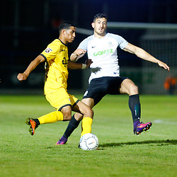 APRIL 1:  Dover Athletic against Bromley in Conference Premier at Crabble Stadium in Dover, England. Bromely's Louis Dennis clears the ball while under pressure from Dover's defender Giancarlo Gallifuoco. (Photo by Matt Bristow/mattbristow.net)